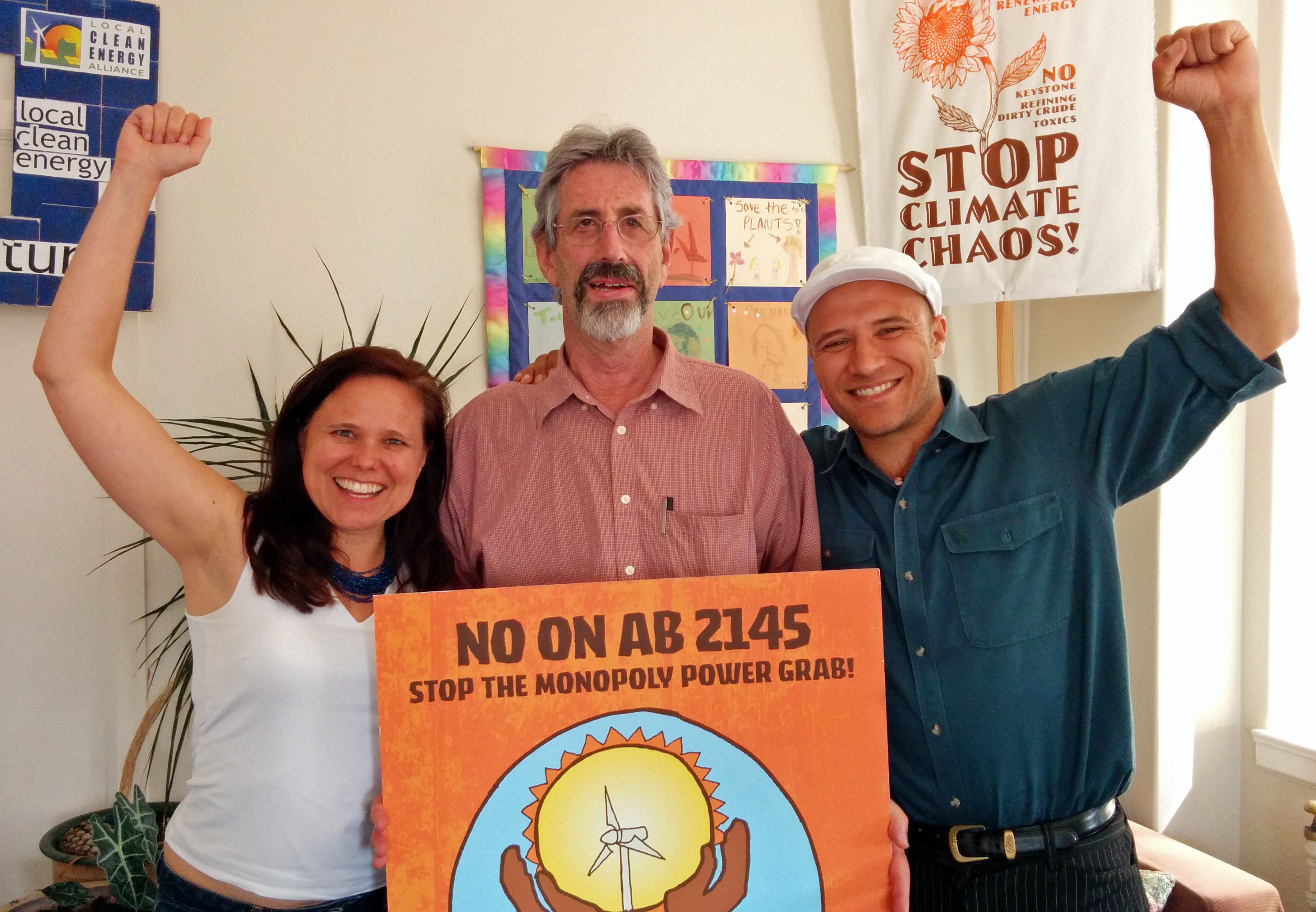 Kirsten Schwind, Local Clean Energy Alliance (LCEA) Steering Committee member, Al Weinrub, LCEA Coordinator, and Colin Miller, Clean Energy & Jobs Oakland Coordinator celebrate the AB 2145 victory.